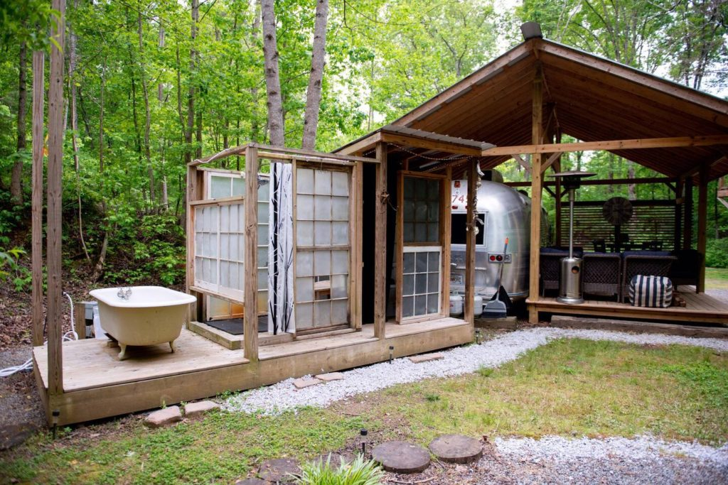 Photo of vintage camper with outdoor bathroom connected