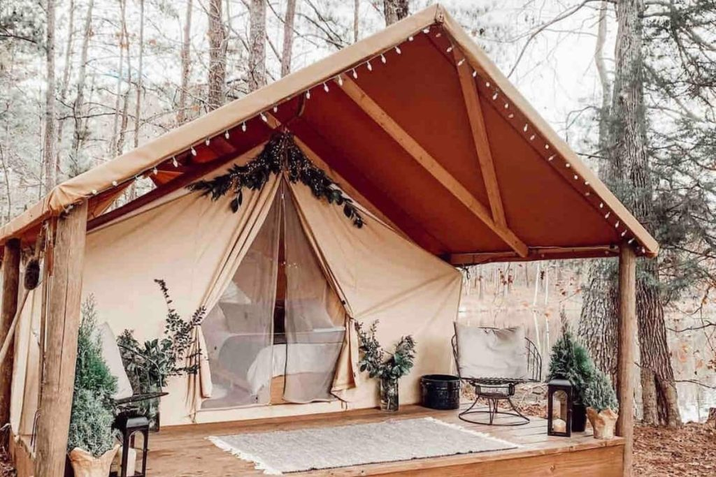 Photo of the heated tent decorated with string lights and holiday decor