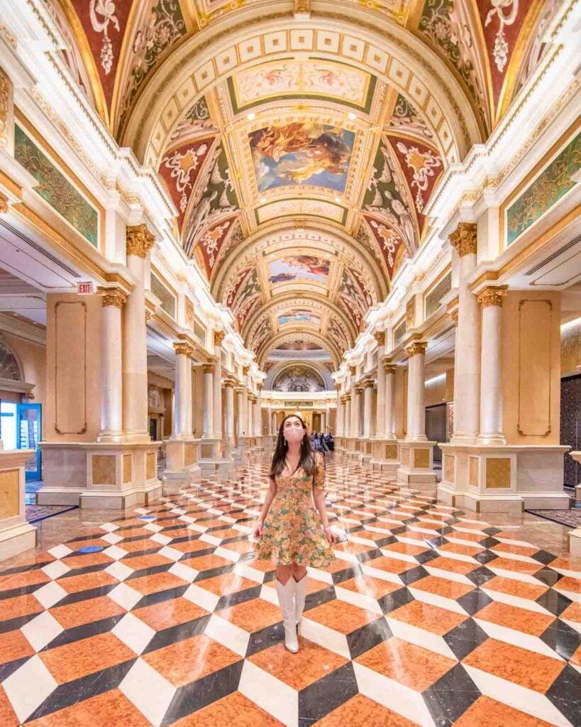 Woman walking through the entrance of the Venetian Resort in Las Vegas