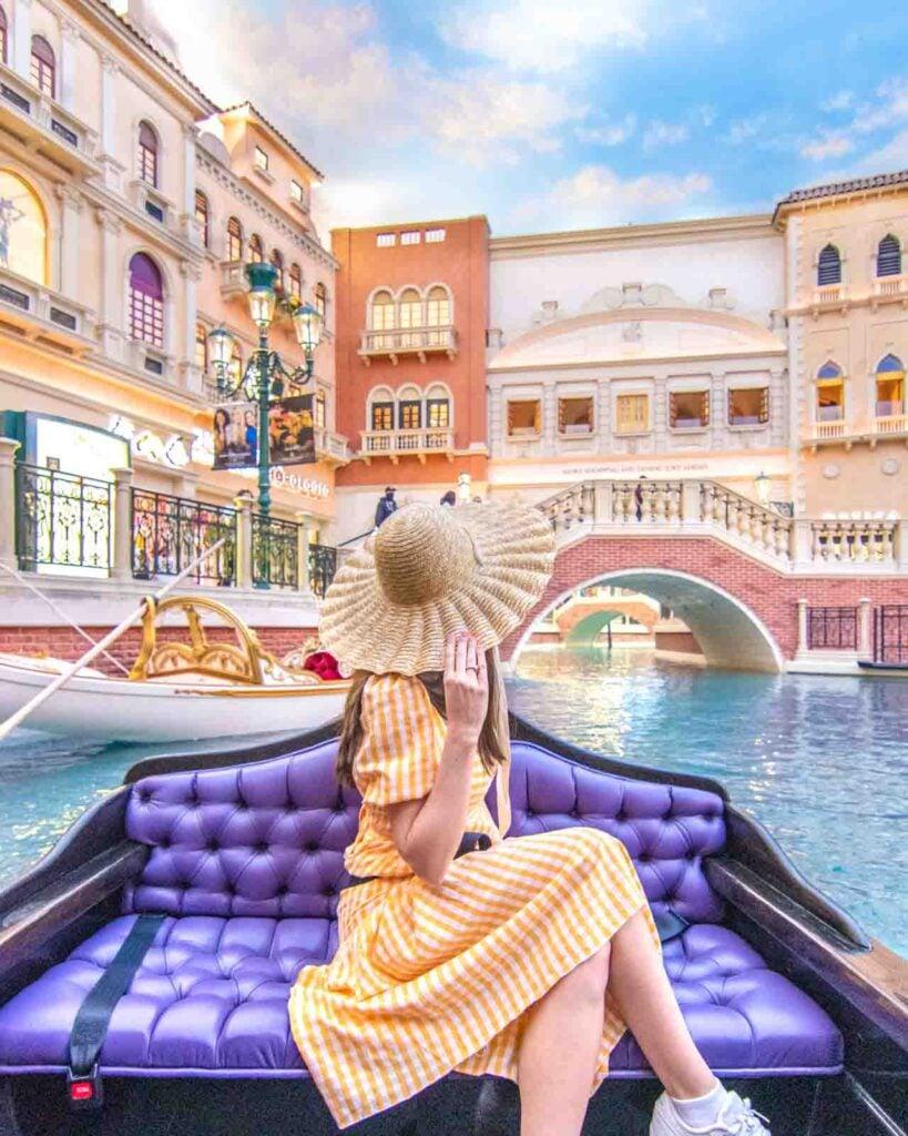Woman facing away on indoor gondola ride at the Venetian in Las Vegas