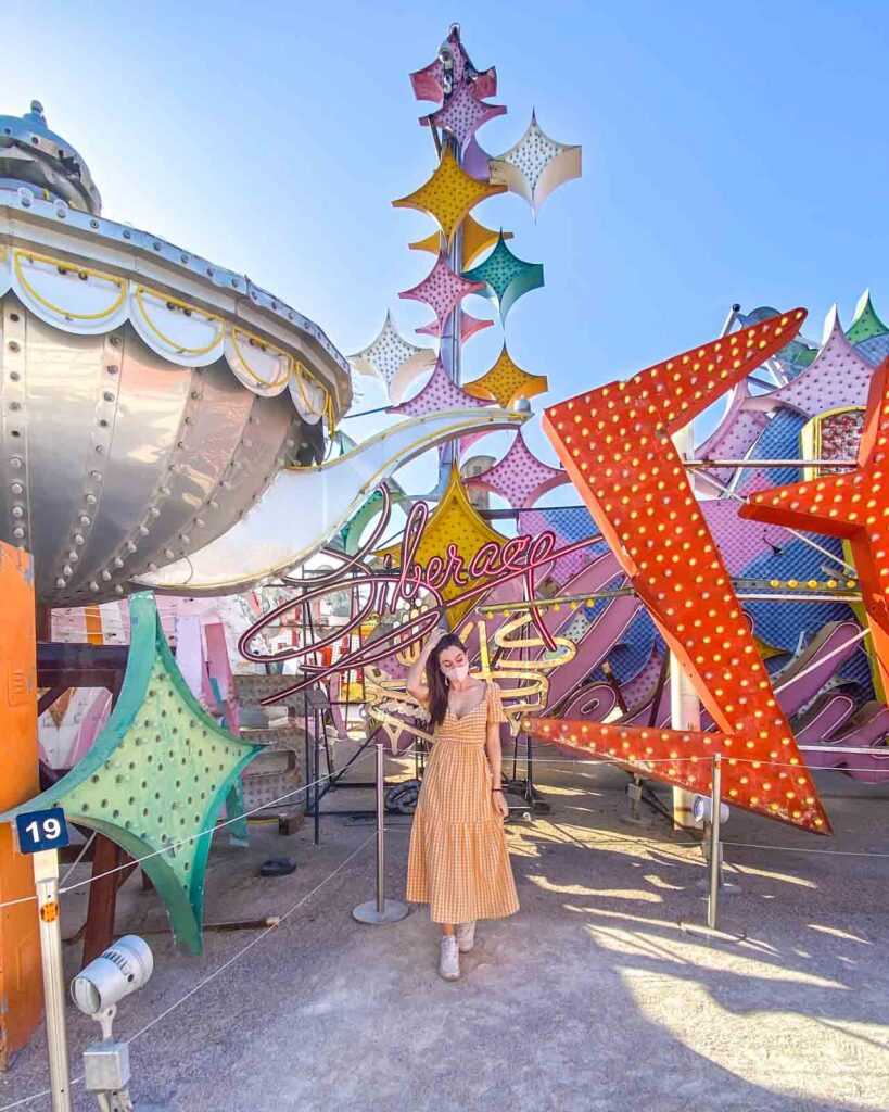 Woman standing in front of colorful neon signs at the Neon Museum in Las Vegas