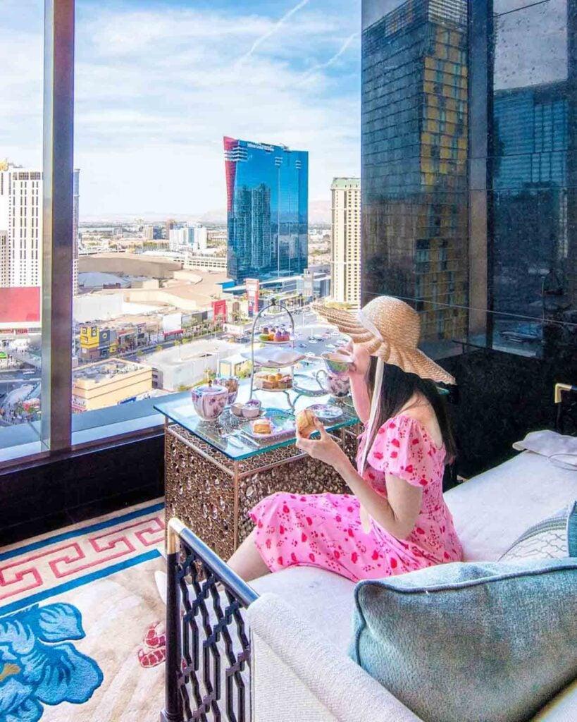 Woman sipping tea at the Tea Lounge at Waldorf Astoria Las Vegas
