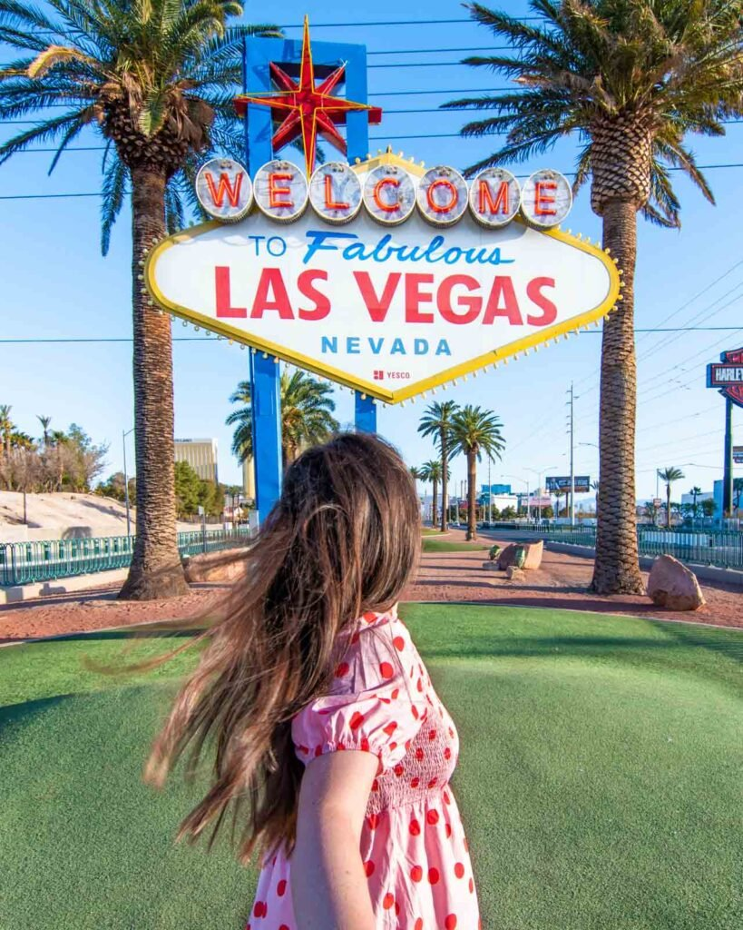 Woman facing the Welcome to Fabulous Las Vegas sign
