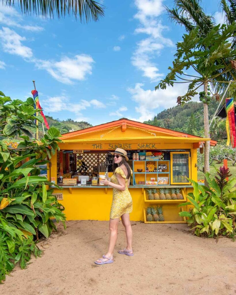 Woman standing in front of the Sunrise Shack at Sunset Beach