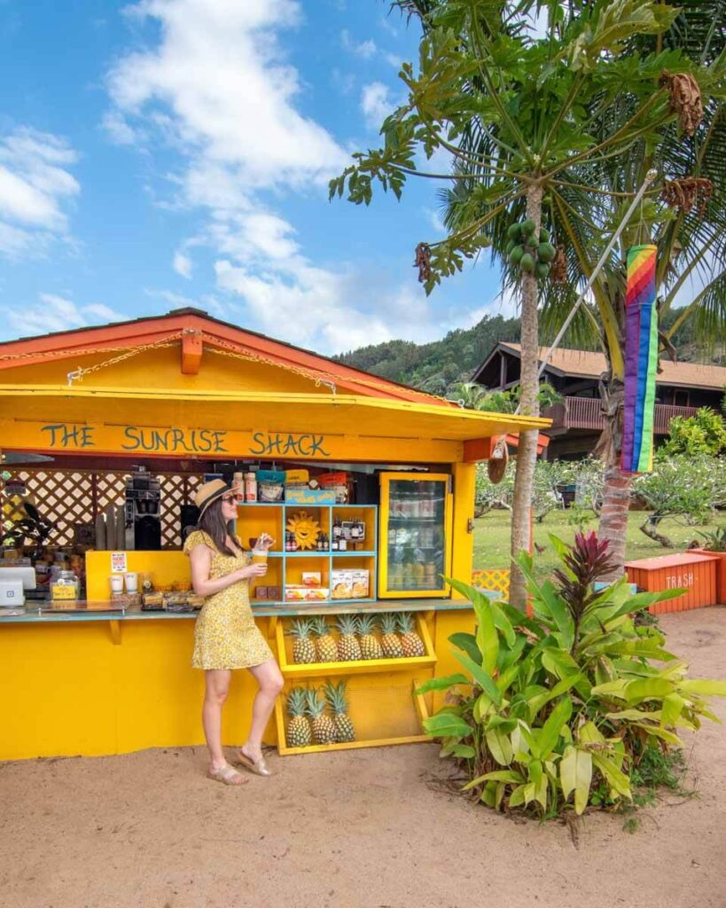 Woman in yellow dress in front of the Sunrise Shack at Sunset Beach on Oahu's North Shore