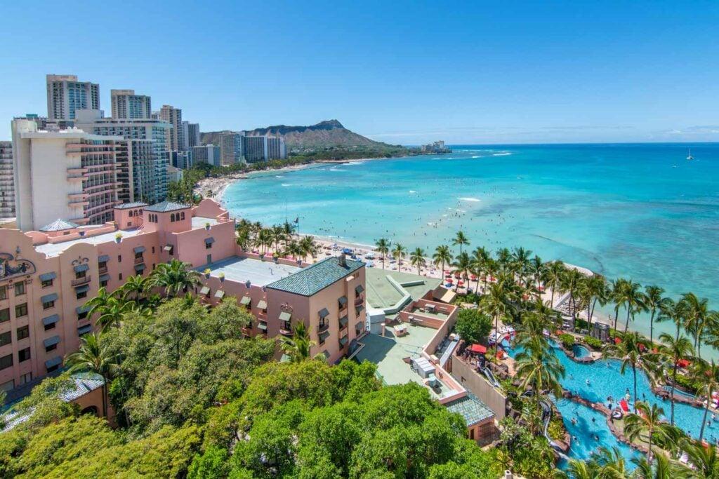 The view from a balcony at the Sheraton Waikiki, showing the Royal Hawaiian and Waikiki Beach in the distance.