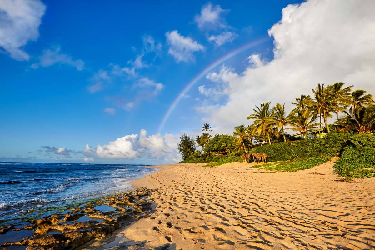 Rainbow over Sunset Beach at the North Shore in Oahu.