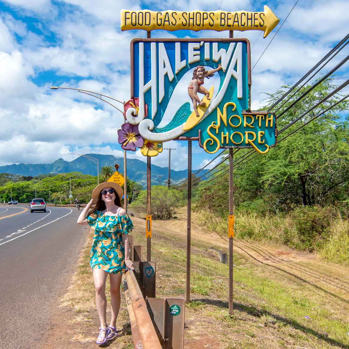 Woman standing next to Haleiwa surfer sign in Haleiwa Town on the North Shore of Oahu